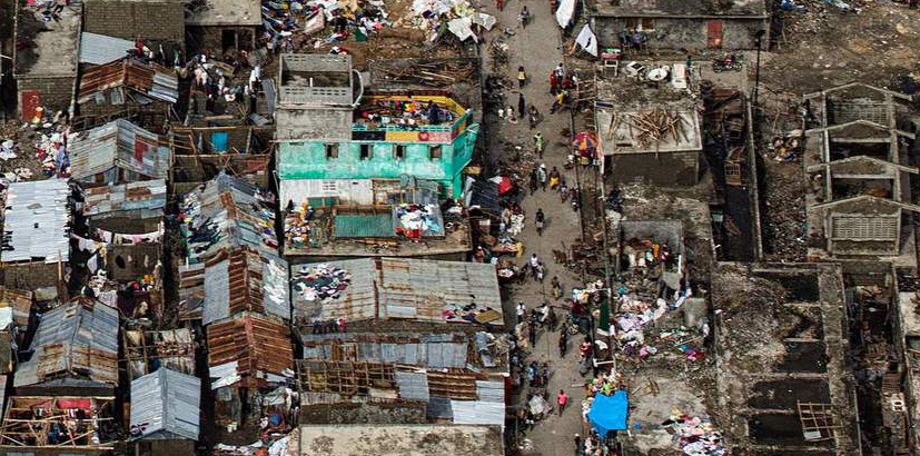 "TOPSHOT - Aerial view taken by the UN Mission in Haiti (MINUSTAH) over the town of Jeremie, Haiti on Thursday October 6, 2016. The city lies on the western tip of Haiti and suffered the full force of the category 4 storm, leaving tens of thousands stranded. Hurricane Matthew passed over Haiti on Tuesday October 4, 2016, with heavy rains and winds. While the capital Port au Prince was mostly spared from the full strength of the class 4 hurricane, the western cities of Les Cayes and Jeremie received the full force sustaining wind and water damage across wide areas. / AFP PHOTO / UN/MINUSTAH / Logan Abassi / RESTRICTED TO EDITORIAL USE - MANDATORY CREDIT ""AFP PHOTO /LOGAN ABASSI / MINUSTAH "" - NO MARKETING - NO ADVERTISING CAMPAIGNS - DISTRIBUTED AS A SERVICE TO CLIENTS LOGAN ABASSI/AFP/Getty Images NYTCREDIT: Logan Abassi/Agence France-Presse -- Getty Images"